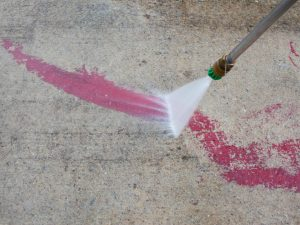 Using Pressure Washer for Cleaning Paint from Concrete